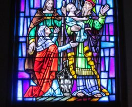 Stained Glass Window blessing baby Jesus in temple